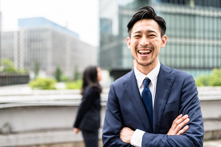 Japanese business persons have fun and laughing